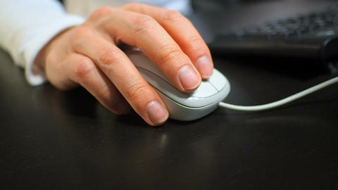 Mouse 10. Soft focus to hand of the man clicking middle mouse button. Right hand Footage