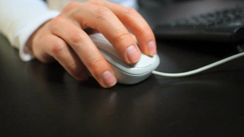 Mouse 11. Soft focus to hand of the man clicking left mouse button. Right hand f Footage