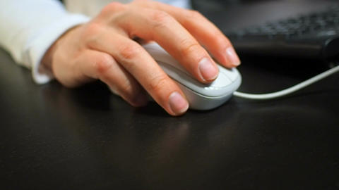 Mouse 12. Soft focus to hand of the man clicking right mouse button. Right hand  Footage