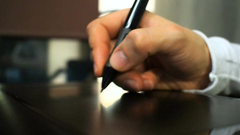 Tablet 20. Close up of the hand of a graphic designer clicking button on electro Footage
