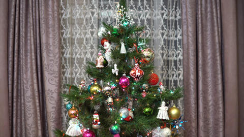 The camera moves away from the decorated Christmas tree. Christmas holiday. The Live Action