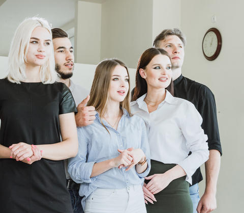 A group of five young friends looks to the imagining horizont Indoors Photo