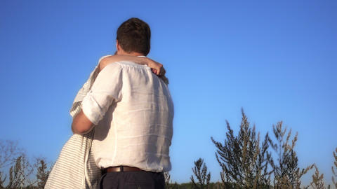 Romantic couple, young girl jumps into the arms of her…, Live Action