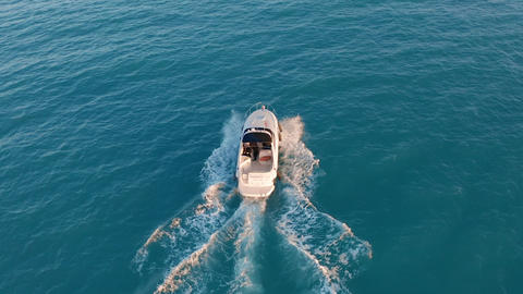 Aerial view. Motor boat sailing in blue sea. Luxury yacht racing deep water Live Action