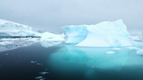 Sailing past icebergs in Antarctica Footage