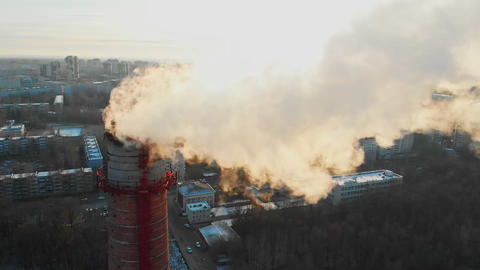 Air pollution - a smoke from industrial pipe pollutes the air in the city - Live Action