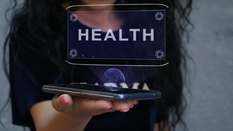 Woman showing HUD hologram Health Live Action