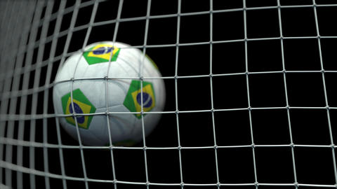 Ball with flags of Brazil hits goal. 3D animation Live Action