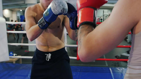 Boxing indoors - two men having a fight on the boxing ring - attack and protect Live Action