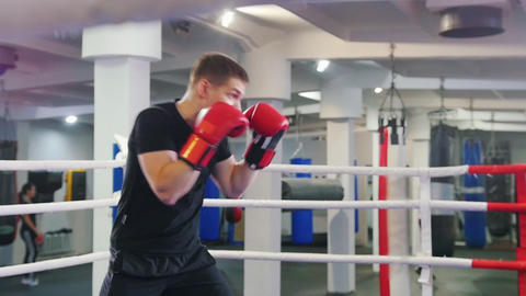 Box training in the gym - a man performing a shadow boxing Live Action