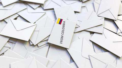 Letter with From Colombia text on pile of other Letters. International mail Live Action