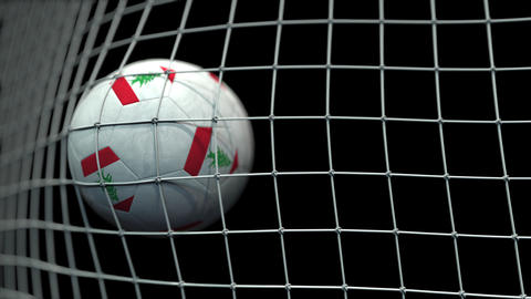 Ball with flags of Lebanon in goal against black background. Conceptual 3D Live Action