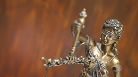 Bronze Statue of Themis and Lady of Justice on Brown Background Live Action