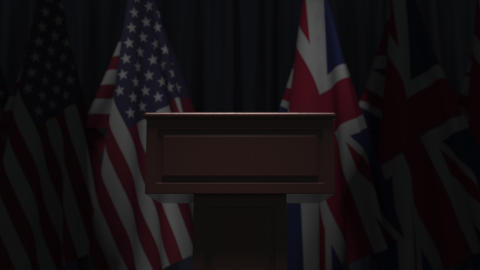 Many flags of Britain and the USA behind speaker tribune, 3D animation Live Action