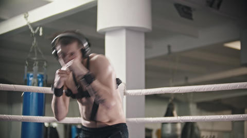 Box training - a man training wearing headphones - shadow fighting wearing Live Action
