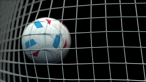 Ball with flags of Luxembourg hits goal. 3D animation Live Action