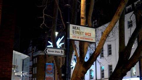 street signs Neal Street and Seven Dials in London - LONDON, ENGLAND - DECEMBER Live Action