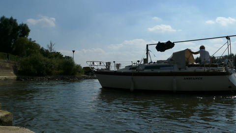 A boat sails in the marina of Zutphen on the river IJssel Footage