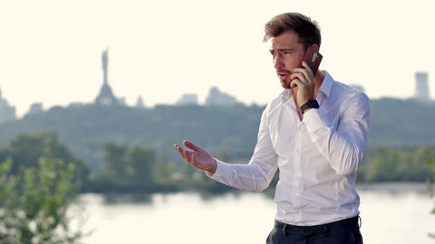 Angry businessman shouting on the phone Footage