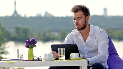 Business man working with a digital tablet Live Action