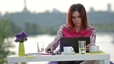 Businesswoman doing online shopping outdoors ビデオ