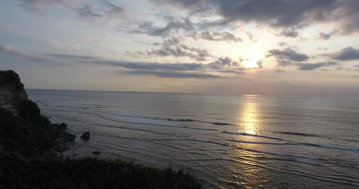 Aerial view along the shore of Bali island, resort, view on the ocean, sunset Live Action