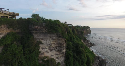 Huge cliffs and rocky beaches of Bali, big resorts on top of the cliffs, 4k Live Action
