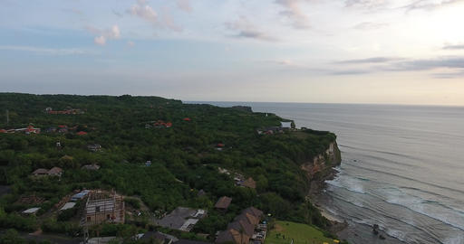 Shoreline and a resort on Bali, aerial view, rocky beach with cliffs, Indonesia Live Action