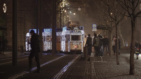 Budapest, Hungary night view of Illuminated Christmas tram on the street Live Action