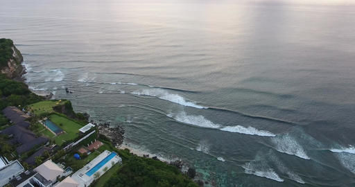 Stunning aerial view on the shoreline of Bali, foamy waves of the ocean, 4k Live Action