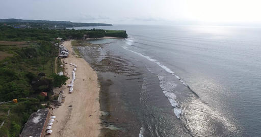 Drone footage of the shoreline of Bali, with long beaches and big cliffs, 4k Live Action