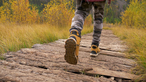 Tourist Man Walks on Trip Natural Landscape in Hike Boots Wooden Trail Closeup Live Action