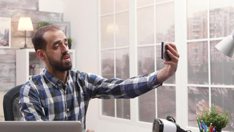 Young content creator using phone to record a vlog Live Action
