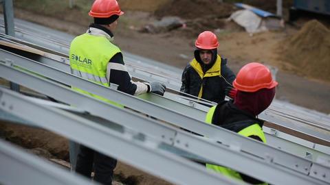 Solar panel technician on panels Live Action