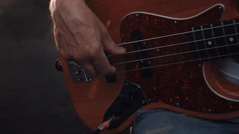 Bassist playing electric bass guitar. Fingers on guitar strings Live Action