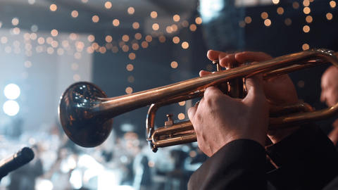 Trumpet player. Trumpeter hands playing brass music instrument close up. Close Live Action