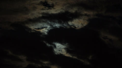 Spooky Moon Behind Clouds Time Lapse Footage