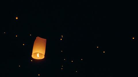 Sky Lanterns Fly Into The Night Sky Footage
