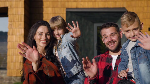 Attractive portrait of happy joyful modern family which posing on camera near Live Action