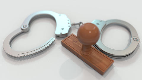 MURDER stamp and handcuffs. Crime and punishment related conceptual 3D animation Live Action