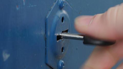 key into safe keyhole Live Action