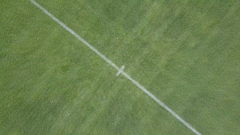 Aerial rotating view rising from center spot of soccer field Live Action