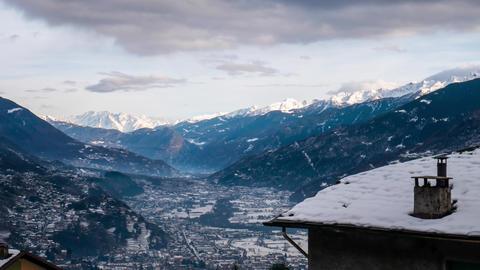 Motionlapse of Adamello mountain at dusk, seen from Valtellina, Italy Live Action