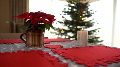 festive table setting for Christmas holidays. lighting candles before dinner Live Action