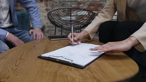 Close Up of businesswoman and businessman are having conversation, draw up a Live Action