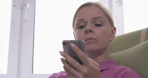 Blonde woman using a smartphone voice recognition function online Live Action