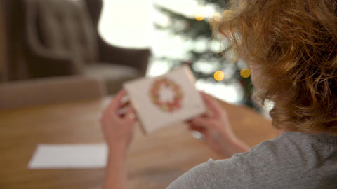 reading a letter with greetings and wishes of beautiful holidays of Live Action