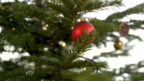 decorating the tree for Christmas holidays in winter Live Action