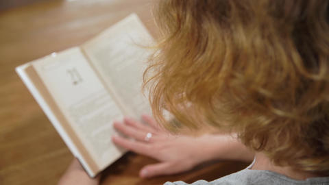 reading a letter with greetings and wishes of beautiful holidays ofwoman reading Live Action