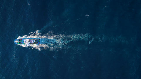 Top view of a fishing boat sailing in the Atlantic Ocean Live Action